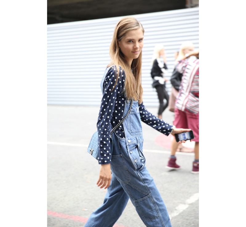 Model Caroline Brasch Nielsen in dungarees with Chanel's Boy bag