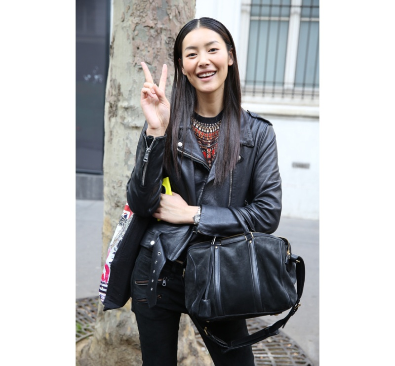 Model Liu Wen in leather jacket with Sofia Coppola for Louis Vuitton bag