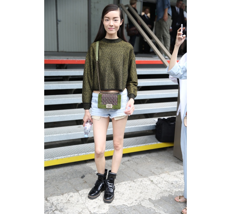 Model Fei Fei Sun in shorts with Chanel's Boy bag