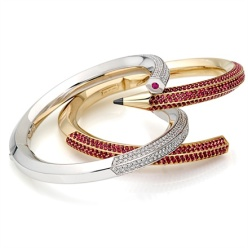 Costis - Gold bracelets with diamonds and rubies or spinels and black diamonds.