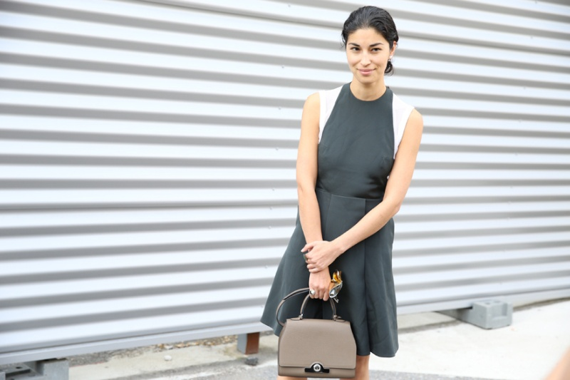 Fashion editor-in-chief at Tank Magazine, Caroline Issa in a grey dress with Moynat bag