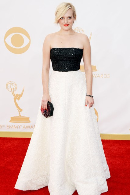 Elisabeth Moss wore an Andrew Gn pre-spring:summer 2014 gown with Neil Lane jewellery and carried a Rauwolf clutch