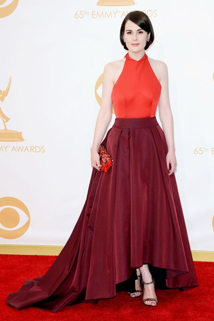 Michelle Dockery wore top-to-toe Prada - a two-tone gown, heels and a clutch - with Fred Leighton jewellery