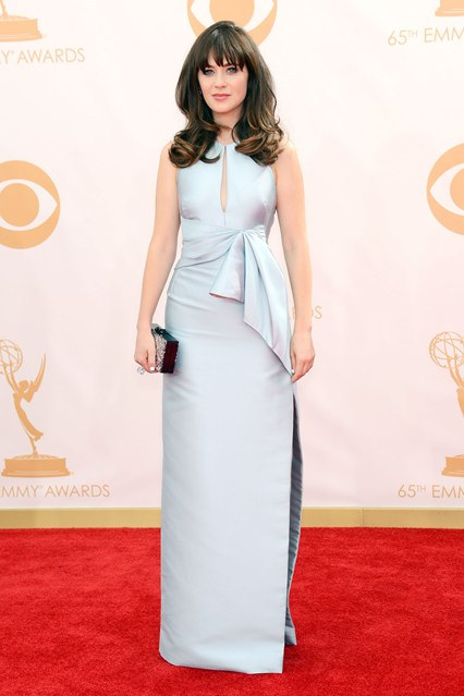 Zooey Deschanel wore a J. Mendel dress accessorised with an Edie Parker clutch and Chanel jewellery