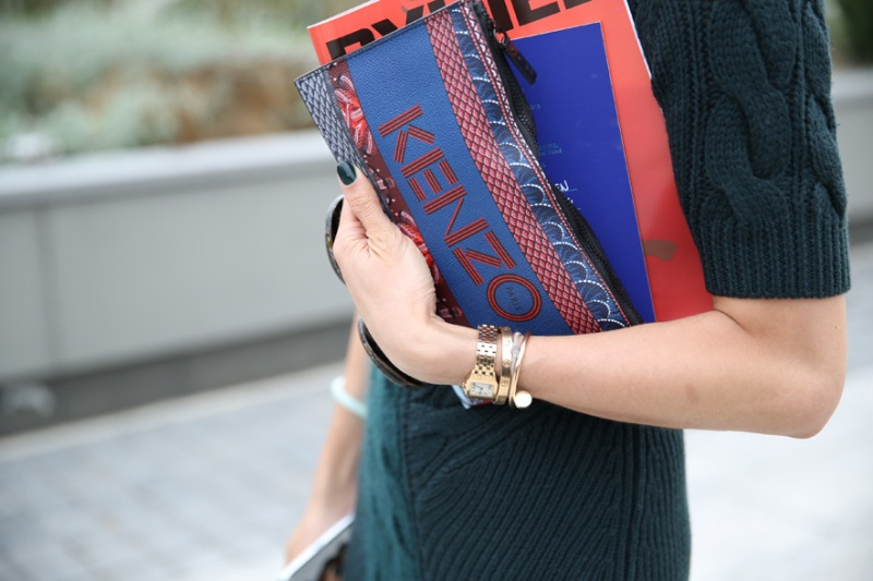 Kenzo clutch with Cartier watch and bracelets