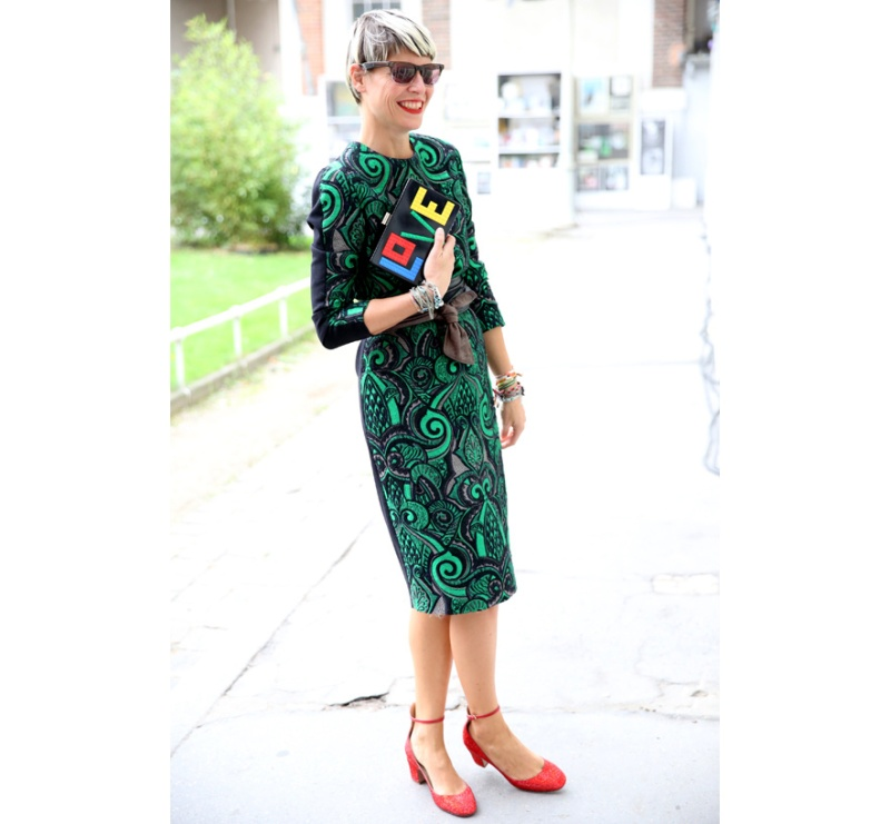Stylist Elisa Nalin in a print dress and shoes by Valentino