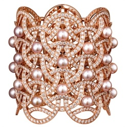 Cartier - Voluptuous. Rose gold cuff with freshwater pearls and white diamonds