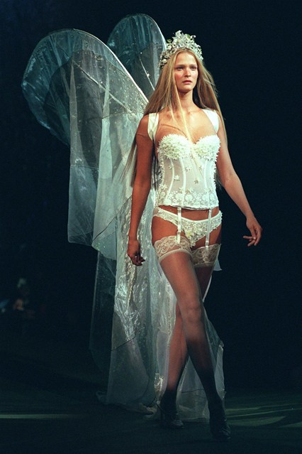 Carmen Kass in wings and a basque at the 1998 show.