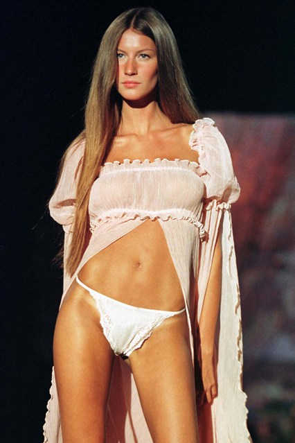 Gisele Bundchen makes her Victoria's Secret debut, aged just 19, at the 1999 show.