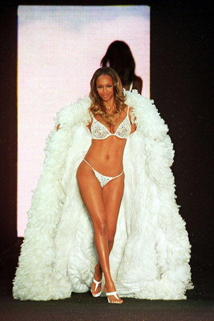 Tyra Banks takes to the catwalk for the 2000 show, held during the amFAR benefit party in Cannes in May.