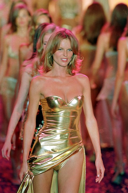 Eva Herzigova leads the way in gold at the 2000 Victoria's Secret show.