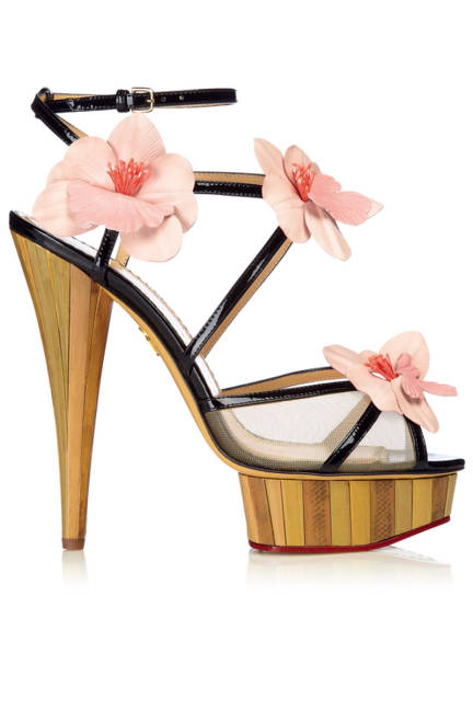 Charlotte Olympia flower and wood wedge sandals.