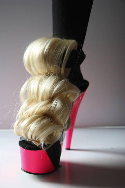 A Lauren Tennenbaum heel incorporates a blonde hair piece.