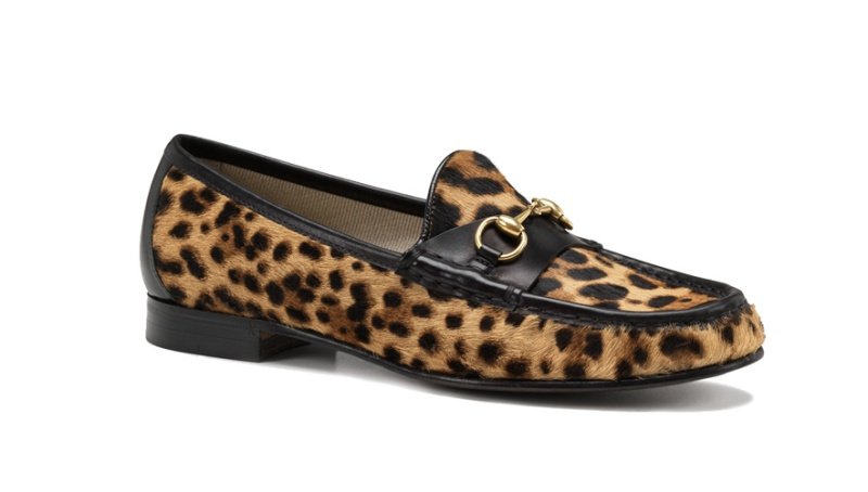 Gucci  1953 leopard print ponyskin moccassins with metal buckle, €650.