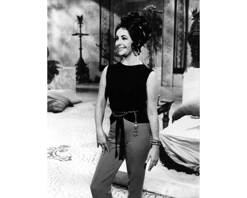 Bulgari: La Dolce Vita & Beyond  Photo: Elizabeth Taylor in 1962 wearing a Serpenti bracelet watch on set for the film Cleopatra.