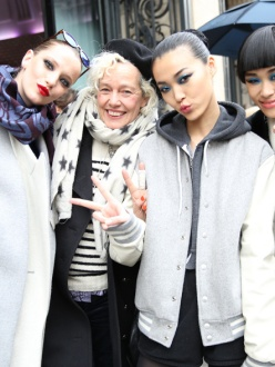 Ellen von Unwerth surrounded by models at the Jean Paul Gaultier Couture Spring/Summer 2014 show