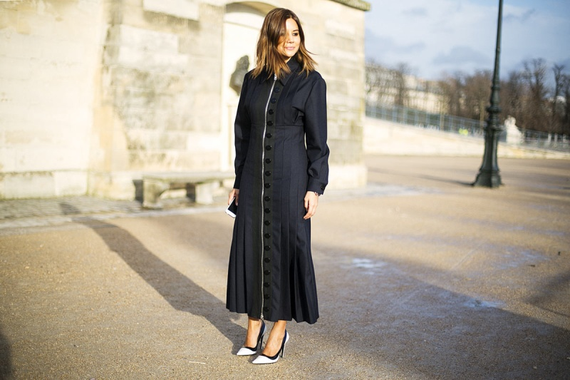 Stylist Christine Centenera, fashion director of the digital edition of Vogue Australia, with a long coat A/W collection of Miu Miu.