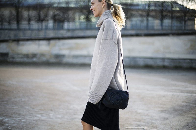 Anja Rubik - Celine sweater, Gucci bag and Giuseppe Zanotti booties.